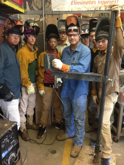LHS Welders Victor Torres, Cameron Garafola, Ricky Paul, Jr., Colby Bergeron, Cade Garafola, Javier Maya, and Fausto Mejia with former student Evan Steib